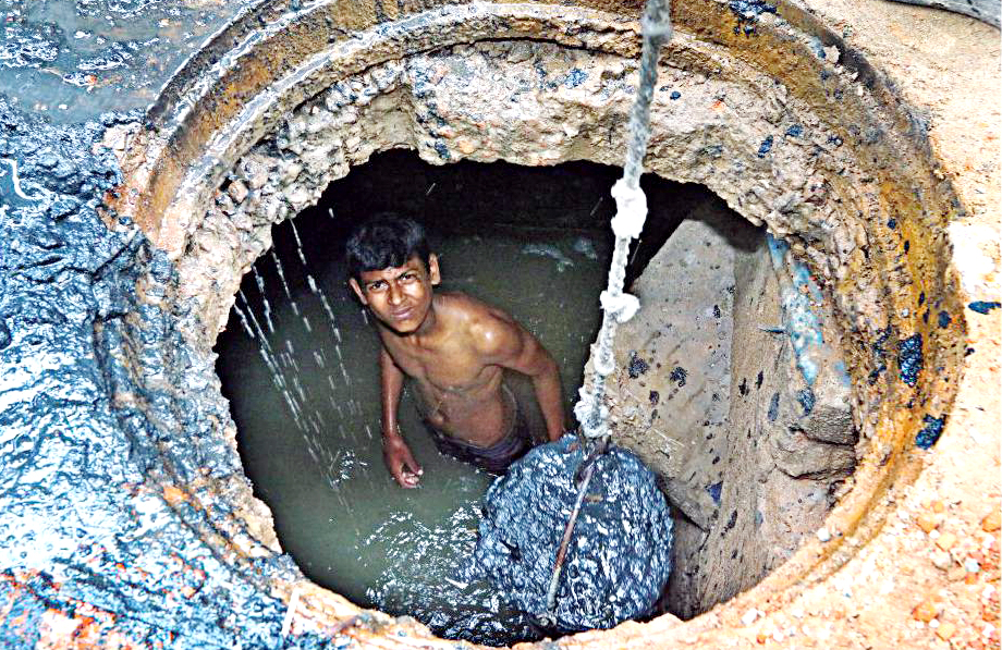 plunging into a pool of waste without safety equipment and barely any clothing, a young clean sewer line in Paltan area. Often times, these worker sustains injuries from working in cramped  drains or suffer from eye problem, respiratory and skin diseases