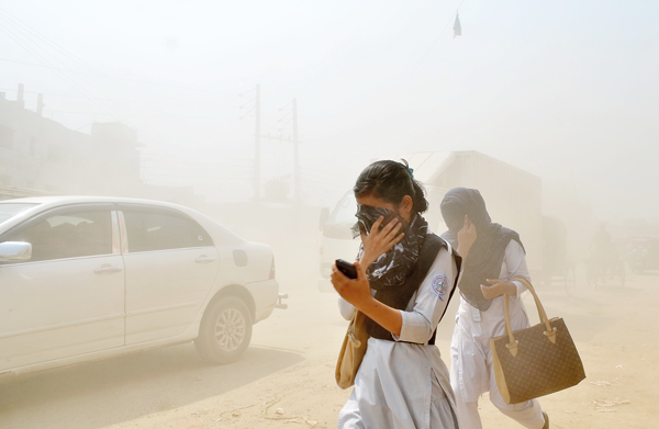 Dust pollution reaches an alarming stage in Dhaka and many deaths as well as several million cases of illness occur every year due to the poor air quality, Dhaka, Bangladesh