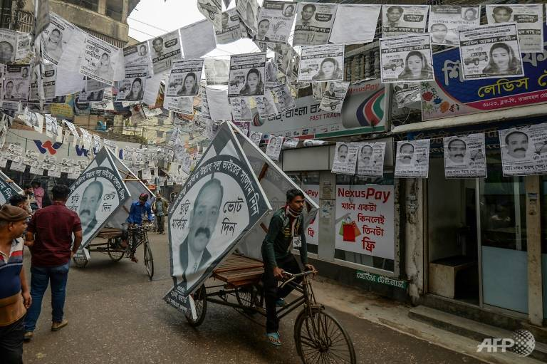 dhaka-is-awash-with-millions-of-plastic-laminated-campaign-posters-ahead-of-elections-1580464359393-3