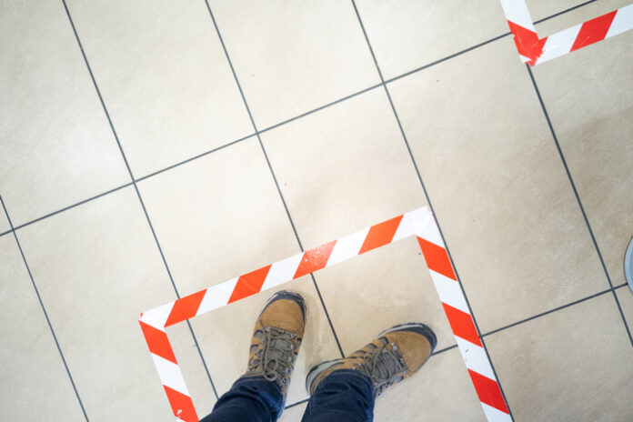 How can retailers maintain social distancing once stores reopen